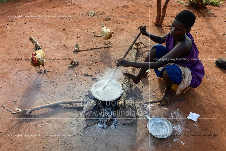 TANZANIA, Korogwe, Massai in Kwalukonge village, women cook maize mash/ TANSANIA, Korogwe, Massai im Dorf Kwalukonge, Frau kocht Maisbrei