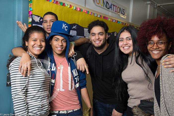 High School group of male and female students posing together in corridor