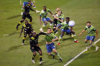 COLUMBUS, OH - DECEMBER 12: Shane O'Neill #27 and Cristian Roldan #7 of Seattle Sounders FC battle for the ball against Gyasi Zardes #11 of Columbus Crew during a game between Seattle Sounders FC and Columbus Crew at MAPFRE Stadium on December 12, 2020 in Columbus, Ohio.