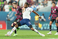 DENVER, CO - JUNE 6: Jordan Siebatcheu #16 of the United States wins the tackle during a game between Mexico and USMNT at Mile High on June 6, 2021 in Denver, Colorado.