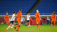 YOKOHAMA, JAPAN - JULY 30: Tobin Heath #7 of the United States in the middle of the Netherlands defense during a game between Netherlands and USWNT at International Stadium Yokohama on July 30, 2021 in Yokohama, Japan.