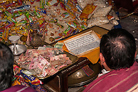 Bodhnath, Nepal.  Monetary and Food Donations Given to Buddhist Monks to Mark the Tibetan New Year.