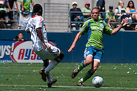 Osvaldo Alonso (r) of the Seattle Sounders drives against Patrick Nyarko (l) of the Chicago Fire in the match at the XBox Pitch at Quest Field on July 25, 2009. The Sounders and Fire played to a 0-0 draw.