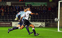 ATTENTION SPORTS PICTURE DESK<br /> Pictured: Darren Pratley of Swansea (R) is denied a goal by goalkeeper Romain Larrieu of Plymouth Argyle (L)<br /> Re: Coca Cola Championship, Swansea City Football Club v Plymouth Argyle at the Liberty Stadium, Swansea, south Wales. Tuesday 08 December 2009
