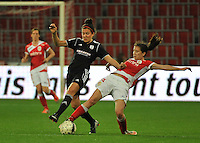 20131009 - LIEGE , BELGIUM : Duel pictured between Standard's Sanne Schoenmakers (right) and Glasgow's Leanne Crichton (left) during the female soccer match between STANDARD Femina de Liege and GLASGOW City LFC , in the 1/16 final ( round of 32 ) first leg in the UEFA Women's Champions League 2013 in stade Maurice Dufrasne - Sclessin in Liege. Wednesday 9 October 2013. PHOTO DAVID CATRY