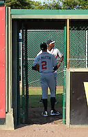 Starting pitcher Sean Gilmartin (2) of the Rome Braves waits in the bullpen with pitching coach Derrick Lewis prior to a game against the Greenville Drive on August 16, 2011, at Fluor Field at the West End in Greenville, South Carolina. Gilmartin was Atlanta's first-round pick (No. 28 overall) in the 2011 First-Year Player Draft out of Florida State. Making his second start of the season, he pitched four scoreless innings, giving up one hit and striking out four. (Tom Priddy/Four Seam Images)