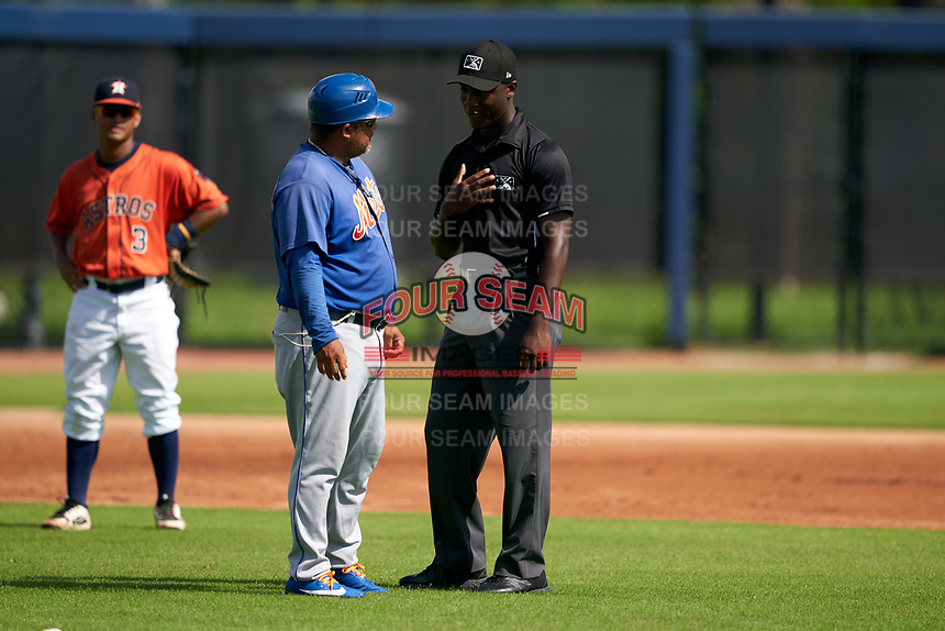GCL Mets manager David Davalillo (4) argues a call with umpire Jaylen Goodman during a Gulf Coast League game against the GCL Astros on August 10, 2019 at FITTEAM Ballpark of the Palm Beaches Training Complex in Palm Beach, Florida.  GCL Astros defeated the GCL Mets 8-6.  (Mike Janes/Four Seam Images)