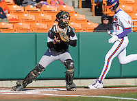 Catcher Luke Feisal (2) of the Wofford Terriers takes a late throw at the plate during the first inning of a game against the Clemson Tigers on Wednesday, March 6, 2013, at Doug Kingsmore Stadium in Clemson, South Carolina. Clemson won, 9-2. (Tom Priddy/Four Seam Images)