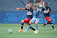 FOXBOROUGH, MA - SEPTEMBER 19: Kelyn Rowe #11 of New England Revolution competes for the ball with Alexander Ring #8 of New York City FC during a game between New York City FC and New England Revolution at Gillette on September 19, 2020 in Foxborough, Massachusetts.