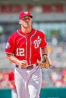 21 June 2015: Washington Nationals first baseman Tyler Moore trots back to the dugout during a game against the Pittsburgh Pirates at Nationals Park in Washington, DC. The Nationals defeated the Pirates 9-2 to sweep their 3-game weekend series, and improve their record to 37-33. Mandatory Credit: Ed Wolfstein Photo *** RAW (NEF) Image File Available ***