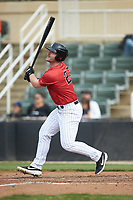 Alex Destino (23) of the Kannapolis Intimidators follows through on his swing against the Rome Braves at Kannapolis Intimidators Stadium on April 7, 2019 in Kannapolis, North Carolina. The Intimidators defeated the Braves 2-1. (Brian Westerholt/Four Seam Images)