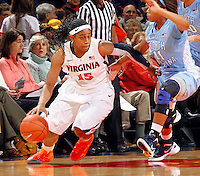 CHARLOTTESVILLE, VA- JANUARY 5: Ariana Moorer #15 of the Virginia Cavaliers handles the ball during the game against the North Carolina Tar Heels on January 5, 2012 at the John Paul Jones arena in Charlottesville, Virginia. North Carolina defeated Virginia 78-73. (Photo by Andrew Shurtleff/Getty Images) *** Local Caption *** Ariana Moorer