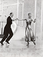 """BNPS.co.uk (01202 558833)<br /> Pic: Bonhams/BNPS<br /> <br /> PICTURED: Ginger Rogers (wearing the necklace) as she dances with Fred Astaire in the """"Swing Trot"""" dance number from The Barkleys of Broadway<br /> <br /> A crystal necklace that was worn by legendary actress Vivien Leigh in Gone With the Wind has emerged for sale for £23,000.<br /> <br /> The stylish piece featured in the film when Leigh's character Scarlett O'Hara is on her honeymoon with Rhett Butler - played by Clark Gable.<br /> <br /> It is seen as Scarlett gorges herself on dinners and desserts, while Rhett informs her that he will divorce her if she gets too fat."""