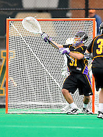 10 April 2011: University at Albany Great Dane goalkeeper John Carroll, a Junior from Nesconset, NY, in action against the University of Vermont Catamounts on Moulton Winder Field in Burlington, Vermont. The Catamounts defeated the visiting Danes 11-6 in America East play. Mandatory Credit: Ed Wolfstein Photo