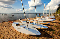 A line of sailboats sit along the Pamlico Sound in North Carolina's Outer Banks. Photo series from Pamlico Sea Base, a Boy Scouts of America High Adventure Camp located on the Pamlico River south of Washington, NC. The BSA Sea Base program is centered around sea kayaking treks on the North Carolina Outer Banks and sailing programs on the historic Pamlico River...Photography by: Patrick Schneider Photo.com