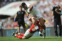 Anthony Watson of England forces his way past Liam Williams of Wales to score a try during the Old Mutual Wealth Cup match between England and Wales at Twickenham Stadium on Sunday 29th May 2016 (Photo: Rob Munro/Stewart Communications)