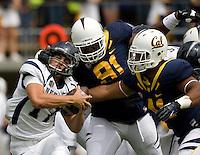 California defenders' Mustafa Jalil and Todd Barr sack Nevada quarterback Cody Fajardo during the game at Memorial Stadium in Berkeley, California on September 1st, 2012.  Nevada Wolf Pack defeated California, 31-24.