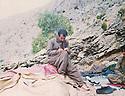 Iraq 1990 .A physician in the mountains near Sengaw, writing his memories  during a rest .Irak 1990 .Medecin dans les montagnes pres de Sengaw ecrivant ses memoires pendant le repos