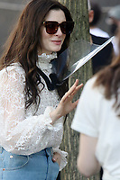 NEW YORK, NY- JUNE 8: Anne Hathaway on the set of the  AppleTV+ Series WeCrashed in New York City on June 8, 2021. <br /> CAP/MPI/RW<br /> ©RW/MPI/Capital Pictures