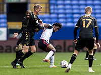 Bolton Wanderers' Peter Kioso competing with Oldham Athletic's Danny Rowe (left) <br /> <br /> Photographer Andrew Kearns/CameraSport<br /> <br /> The EFL Sky Bet League Two - Bolton Wanderers v Oldham Athletic - Saturday 17th October 2020 - University of Bolton Stadium - Bolton<br /> <br /> World Copyright © 2020 CameraSport. All rights reserved. 43 Linden Ave. Countesthorpe. Leicester. England. LE8 5PG - Tel: +44 (0) 116 277 4147 - admin@camerasport.com - www.camerasport.com