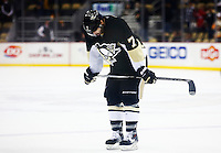 Matt Cullen #7 of the Pittsburgh Penguins skates to the bench following a 4-1 loss to the Washington Capitals during the game at Consol Energy Center in Pittsburgh, Pennsylvania on December 14, 2015. (Photo by Jared Wickerham / DKPS)