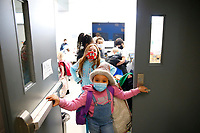Jaylah Hall, 7, waits in line before going to the gymnasium at the Boys and Girls Club of Western Pennsylvania in the Lawrenceville neighborhood on Friday February 19, 2021 in Pittsburgh, Pennsylvania. (Photo by Jared Wickerham/Pittsburgh City Paper)