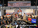 Matt Kenseth, driver of the (17) Crown Royal Black Ford, hoists the trophy up overhead after winning the Samsung Mobile 500 Sprint Cup race at Texas Motor Speedway in Fort Worth,Texas.