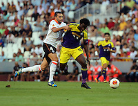 Valencia, Spain. Thursday 19 September 2013<br /> Pictured: Wilfried Bony of Swansea (R) is brought down by Adil Rami of Valencia, for which the latter saw a straight red card by match referee.<br /> Re: UEFA Europa League game against Valencia C.F v Swansea City FC, at the Estadio Mestalla, Spain,