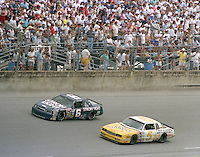 NASCAR Wnston Cup drivers Mark Martin (#6 Strohs Ford) and Geoff Bodine (#5 Levi Garrett Chevrolet) battle for position during the Pepsi Firecracker 400 at Daytona International Speedway in Daytona Beach, FL on July 2, 1988.  Martin  finished 17th and Bodine 16th  in the race.  (Photo by Brian Cleary/bcpix.com)