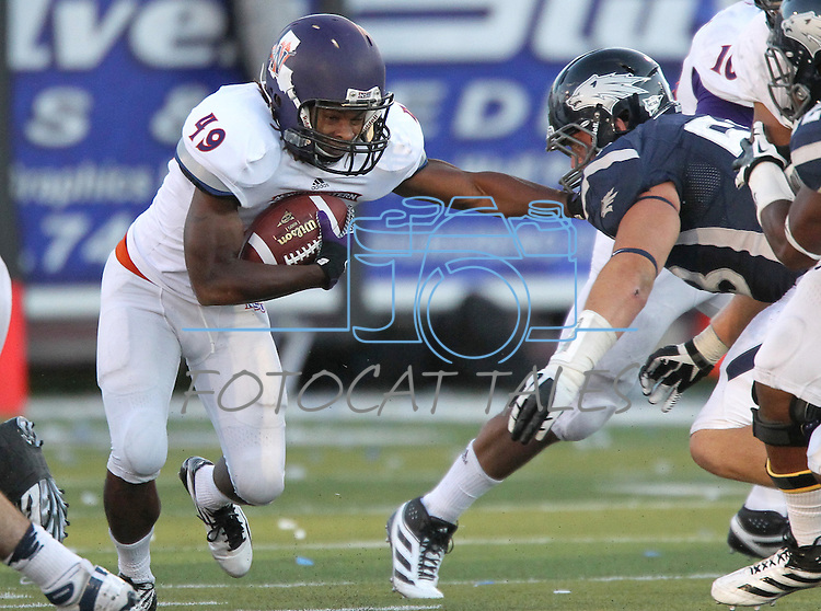 Northwestern State's Daniel Taylor (49) runs up the middle against Nevada during the second half of an NCAA college football game Saturday, Sept. 15, 2012, in Reno, Nev. (AP Photo/Cathleen Allison)