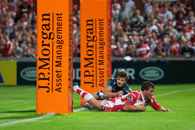 20130801 Copyright onEdition 2013 ©<br />Free for editorial use image, please credit: onEdition.<br /><br />Gareth Evans of Gloucester Rugby 7s scores a try during the J.P. Morgan Asset Management Premiership Rugby 7s Series.<br /><br />The J.P. Morgan Asset Management Premiership Rugby 7s Series kicks off for the fourth season on Thursday 1st August with Pool A at Kingsholm, Gloucester with Pool B being played at Franklin's Gardens, Northampton on Friday 2nd August, Pool C at Allianz Park, Saracens home ground, on Saturday 3rd August and the Final being played at The Recreation Ground, Bath on Friday 9th August. The innovative tournament, which involves all 12 Premiership Rugby clubs, offers a fantastic platform for some of the country's finest young athletes to be exposed to the excitement, pressures and skills required to compete at an elite level.<br /><br />The 12 Premiership Rugby clubs are divided into three groups for the tournament, with the winner and runner up of each regional event going through to the Final. There are six games each evening, with each match consisting of two 7 minute halves with a 2 minute break at half time.<br /><br />For additional images please go to: http://www.w-w-i.com/jp_morgan_premiership_sevens/<br /><br />For press contacts contact: Beth Begg at brandRapport on D: +44 (0)20 7932 5813 M: +44 (0)7900 88231 E: BBegg@brand-rapport.com<br /><br />If you require a higher resolution image or you have any other onEdition photographic enquiries, please contact onEdition on 0845 900 2 900 or email info@onEdition.com<br />This image is copyright the onEdition 2013©.<br /><br />This image has been supplied by onEdition and must be credited onEdition. The author is asserting his full Moral rights in relation to the publication of this image. Rights for onward transmission of any image or file is not granted or implied. Changing or deleting Copyright information is illegal as specified in the Copyright, Design and Patents Act 1988. If you 