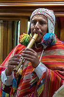 Peru.  Peruvian Quechua Indian Musician Playing the Flute on Inca Rail Executive Class Train from Ollantaytambo to Machu Picchu.