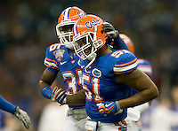 01 January 2010:  Ahmad Black of Florida celebrates with Brandon Spikes of Florida after Spikes made a huge tackle during the game against Cincinnati during Sugar Bowl at the SuperDome in New Orleans, Louisiana.  Florida defeated Cincinnati, 51-24.