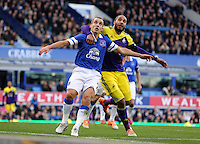 Pictured: Ashley Williams of Swansea (R) against Leon Osman of Everton. Sunday 16 February 2014<br /> Re: FA Cup, Everton v Swansea City FC at Goodison Park, Liverpool, UK.