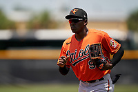 Baltimore Orioles JC Encarnacion (93) jogs to the dugout during a Minor League Spring Training game against the Tampa Bay Rays on April 23, 2021 at Charlotte Sports Park in Port Charlotte, Florida.  (Mike Janes/Four Seam Images)