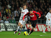 Pictured L-R: Mark Gower of Swansea challenging Ji-Sung Park of Manchester United. Saturday 19 November 2011<br />