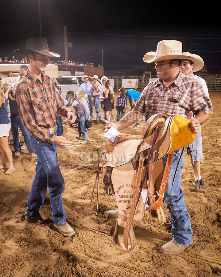 75th Amador County Fair, Plymouth, Calif.<br /> <br /> Jason Belli presents to Jason Whittle the Benny Brown Memorial all-around cowboy saddle during the Mutton Bustin' finals at the Saturday night rodeo