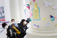 "Springdale High students Tamashiro Tamashiro, 17, (from left) Lual Lah, 16, Tray Reh, 17 and Johan Torres, 15, look on at a new art installation, Friday, September 11, 2020 at Springdale High School in Springdale. About 600 Springdale High School art students and all of the art teachers created a large origami butterfly installation to hang in the school's rotunda. The theme is ""hope"", and each student wrote a personal hope or dream on origami paper then folded it into a butterfly. Check out nwaonline.com/200912Daily/ for today's photo gallery. <br /> (NWA Democrat-Gazette/Charlie Kaijo)"