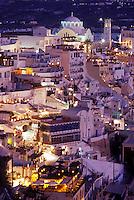 Santorini, Greek Islands, Fira, Cyclades, Greece, Europe, Village of Fira on the steep hillside of Santorini Island in the evening on the Aegean Sea.