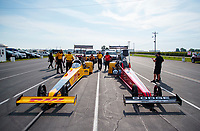 Aug 9, 2020; Clermont, Indiana, USA; The dragsters of NHRA top fuel drivers Shawn Langdon (left) and Leah Pruett sit in the staging lanes during the Indy Nationals at Lucas Oil Raceway. Mandatory Credit: Mark J. Rebilas-USA TODAY Sports