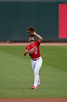 St. Louis Cardinals shortstop Paul DeJong (11) catches a popup during a Major League Spring Training game against the Houston Astros on March 20, 2021 at Roger Dean Stadium in Jupiter, Florida.  (Mike Janes/Four Seam Images)