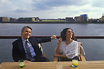 David Owen  and wife Debbie. Politician 1980s England. In their Narrow Street Wapping east London apartment, view across the river Thames.
