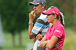 USA Paula Creamer (front) talks to her caddie (behind) on the 7th hole at the LPGA Championship 2011 Sponsored By Wegmans at Locust Hill Country Club in Rochester, New York on June 24, 2011