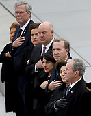 Former U.S. President George W. Bush (R) and his wife Laura watch as a U.S. military honor guard team carries the flag draped casket of former U.S. President George H. W. Bush from the U.S. Capitol December 5, 2018 in Washington, DC. A funeral service will be held today for former U.S. President Bush at the Washington National Cathedral. President Bush will be buried at his final resting place at the George H.W. Bush Presidential Library at Texas A&M University in College Station, Texas. A WWII combat veteran, Bush served as a member of Congress from Texas, ambassador to the United Nations, director of the CIA, vice president and 41st president of the United States.<br /> Credit: Win McNamee / Pool via CNP
