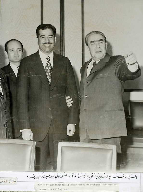 """Moscow?, March 24, 1973..Saddam Hussein with Soviet president Leonid Brejnev..Photograph recovered by Bruno Stevens in the looted """"Triumphant Leader"""" museum in Baghdad, entirely dedicated to the glory of Saddam Hussein."""