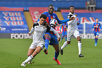 Antonee Robinson of Fulham and Christian Benteke of Crystal Palace battle for the ball during the Premier League behind closed doors match between Crystal Palace and Fulham at Selhurst Park, London, England on 28 February 2021. Photo by Vince Mignott / PRiME Media Images.