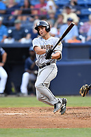 Charleston RiverDogs third baseman Mandy Alvarez (21) swings at a pitch during a game against the Asheville Tourists at McCormick Field on July 6, 2017 in Asheville, North Carolina. The Tourists defeated the RiverDogs 13-9. (Tony Farlow/Four Seam Images)