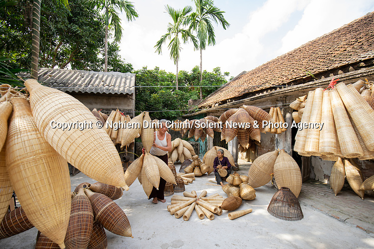 "Villagers sit and weave intricate baskets by hand in a quiet courtyard.  Workers in this Vietnamese village have been making the bamboo containers this way for the past 200 years.<br /> <br /> Amateur photographer Đình Chính Nghiêm, who captured the images in the Thu Sy commune in the Hung Yen province of Vietnam, said a skilled worker will take less an hour to make a whole basket.  The 23-year-old, from Dong Anh Town, in Hanoi, Vietnam, added: ""The baskets are used for many purposes such as fishing, keeping chickens, and decoration.  SEE OUR COPY FOR DETAILS.<br /> <br /> Please byline: Nghiem Dinh Chinh/Solent News<br /> <br /> © Nghiem Dinh Chinh/Solent News & Photo Agency<br /> UK +44 (0) 2380 458800"