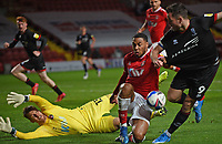 4th May 2021; The Valley, London, England; English Football League One Football, Charlton Athletic versus Lincoln City; Tom Hopper takes on the Charlton defence but the effort saved by keeper Alex Palmer of Lincoln City