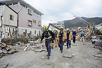 Members of the Fairfax County Urban Fire and Rescue Team head into downtown Ofunato to search for survivors following an 8.9-magnitude earthquake, which triggered a devastating tsunami through this Japanese coastal city. Teams from the United States, United Kingdom and China are on scene to assist in searching for missing residents.